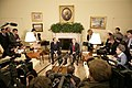 President George W. Bush talks to reporters during a visit with Italian Prime Minister Silvio Berlusconi.jpg