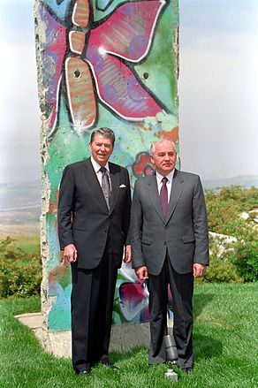President Reagan poses with Mikhail Gorbachev by the piece of the Berlin Wall at Library.jpg