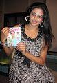Priyamani with a Malayalam magazine.jpg