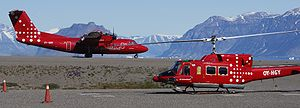 Qaarsut Airport - Air Greenland passengers transfer between Bell 212 helicopters and fixed-wing aircraft in Qaarsut