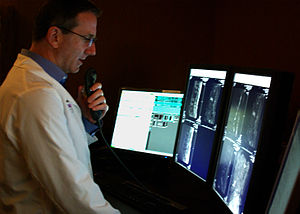 A radiologist interprets medical images on a m...