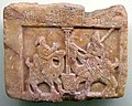 Relief. Man and woman on camels near a well. An ancient South Arabian script appears. From the pre-Islamic Arabian Peninsula, 4th to 1sth century BCE. Ancient Orient Museum, Istanbul, Turkey.jpg