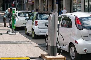 Electric car use by country - Several electric cars charging in downtown Toronto. From farthest to closest, a Nissan Leaf, a Smart ED, and a Mitsubishi i MiEV.