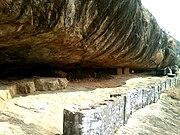 Rock-cut buddhist cave ruins at Gurubhaktula Konda ramatheerrtham