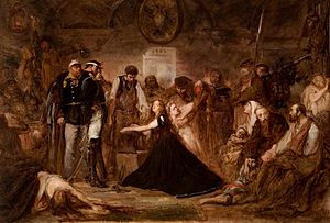 """""""Polonia (Poland), 1863,"""" by Jan Matejko, 1864, oil on canvas, 156 × 232 cm, National Museum, Kraków. Pictured is the aftermath of the failed January 1863 Uprising. Captives await transportation to Siberia. Russian officers and soldiers supervise a blacksmith placing shackles on a woman (Polonia). The blonde next to her may represent Lithuania."""