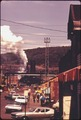 STREET IN CLAIRTON, PENNSYLVANIA, 20 MILES SOUTH OF PITTSBURGH. IN THE BACKGROUND IS A PORTION OF A COKE PLANT OWNED... - NARA - 557224.tif