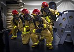 Sailors man a fire hose during a general quarters drill aboard USS Dwight D. Eisenhower. (35842396186).jpg