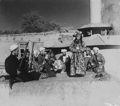 Samarkand A group of musicians playing for a bacha dancing boy.jpg