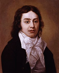 Half-length portrait of man wearing a black jacket and white shirt with an elaborate white bow at the neck. He has wavy, medium-length brown hair.