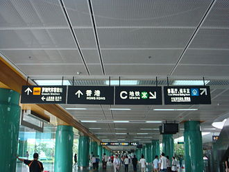 Shenzhen Railway Station - Sign directing passengers to in-station services, local transportation, and to Hong Kong
