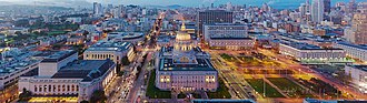 Civic Center, San Francisco - Aerial view of Civic Center at dusk in 2016, facing north. San Francisco City Hall is featured in the center.