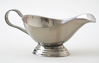 Metal - A metal in the form of a gravy boat made from stainless steel, an alloy largely composed of iron, carbon, and chromium