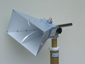 Horn antenna - Pyramidal microwave horn antenna, with a bandwidth of 0.8 to 18 GHz.  A coaxial cable feedline attaches to the connector visible at top.  This type is called a ridged horn; the curving fins visible inside the mouth of the horn increase the antenna's bandwidth.