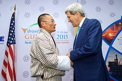 Prime Minister of Bhutan Tshering Tobgay with U.S. Secretary of State John Kerry in 2015. Secretary Kerry shakes hands with Bhutanese Prime Minister Tobgay before bilateral meeting at Vibrant.jpg