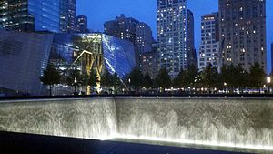 Casualties of the September 11 attacks - September 11th Memorial fountain at base of where one of the towers once stood, and the associated museum at left