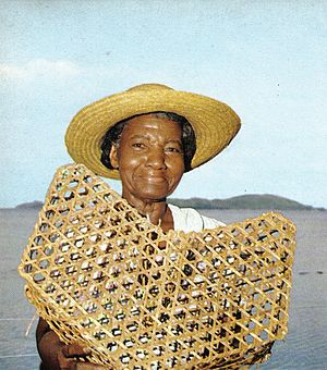 Women in Seychelles - A woman in the Seychelles and her fishtrap, during the early part of the 1970s.