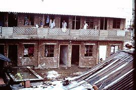 Slums-of-Mumbai-1979-two-storey-building-IHS-87-08.jpeg