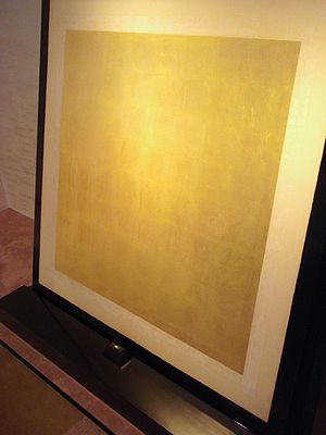 Gold leaf - A gold nugget of 5 mm in diameter (bottom) can be expanded through hammering into a gold foil of about 0.5 square meter. Toi museum, Japan.