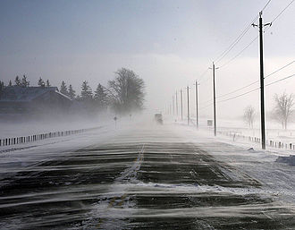 Classifications of snow - Snow blowing across a highway in Canada