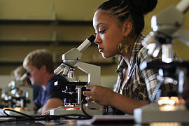 Southern Arkansas University Biology student with microscope.jpg