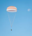 Soyuz TMA-21 capsule descends toward landing.jpg