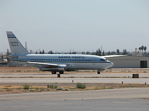 Sierra Pacific Airlines - A Boeing 737-200 takes off from Meadows Field, Bakersfield, California