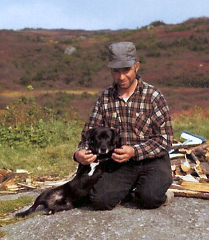 St. John's water dog - Newfoundland outport fisherman with his young St. John's water dog, photographed 1971 in La Poile, Newfoundland.
