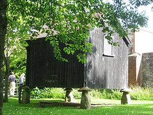 Staddle stones - A building sitting on staddle stones, at the Somerset Rural Life Museum