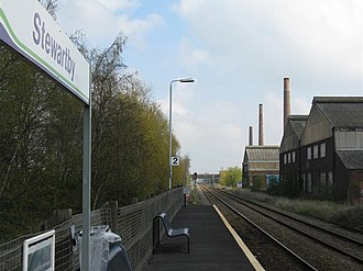 Stewartby railway station - Looking north-east with three of the four surviving and listed brickworks chimneys in view