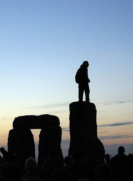 File:Stonehenge Summer Solstice man on stones.jpg
