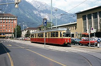 Innsbruck Hauptbahnhof - Stubai Valley tram, Südtiroler Platz, and post-war station building in the 1970s.
