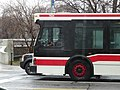 TTC bus 7264 proceeding west at Sherbourne and Bloor, 2014 12 17 (2) (15860767050).jpg
