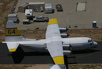 2002 United States airtanker crashes - C-130A Tanker 64 operated by TBM, Inc., similar to N130HP. In this image, the white wing center section area can be easily seen in contrast with the light grey of the wings.