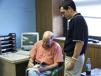 Terry Pluto - Pluto signing one of his books for a Benedictine High School student