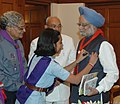 The Cadet of Bharat Scouts and Guides pinning up a flag to the Prime Minister, Dr. Manmohan Singh, in New Delhi on November 07, 2007.jpg