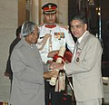 The President, Dr. A.P.J. Abdul Kalam presenting the Padma Bhushan Award – 2006 to Cardiology Specialist Dr. Kewal Krishan Talwar, in New Delhi on March 20, 2006.jpg