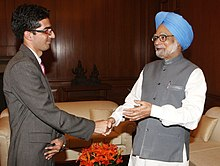 The Prime Minister, Dr. Manmohan Singh congratulating Dr. Shah Faisal, the Civil Services topper for 2010 from Jammu & Kashmir, in New Delhi on May 26, 2010.jpg