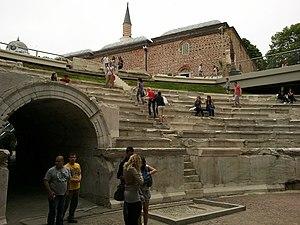 Plovdiv Roman Stadium - The sfendona and Dzhumaya mosque - view from the stadium track.