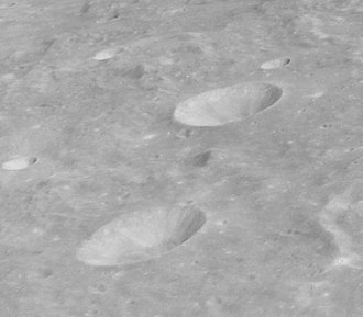 Theon Junior (crater) - Oblique view of Theon Senior (top) and Theon Junior (bottom) from Apollo 16