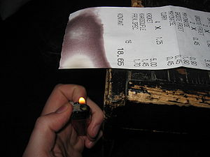 Thermal paper - A receipt printed on thermal paper. A heat source near the paper will color the paper.