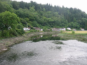 Tintern - The River Wye viewed from the former wireworks railway bridge with Tintern Parva in the background