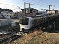 Train for Omuta Station near Matsubaraguchizutsumi Pond.jpg