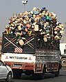 Transporting used plastic caness.jpg
