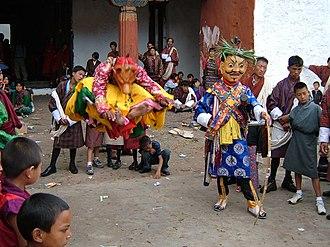 Public holidays in Bhutan - Masked cham dancers, Wangdue Phodrang tsechu