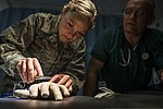 U.S. Air Force Lt. Col. Brandon Isaacs, right, a contract physician with the 366th Medical Operations Squadron (MDOS), observes as Senior Airman Megan Stanton, a medic also with the 366th MDOS, ties a suture on 130716-F-NW635-258.jpg