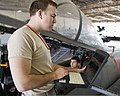 U.S. Air Force Staff Sgt. Corey Eckel instructs Airman Michael Stiffler, both with the 364th Training Squadron, practices removing and installing hydraulic components on an F-15 Fighting Falcon aircraft at 110923-F-NF756-006.jpg