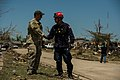 U.S. Air Force Tech. Sgt. Brandon White, left, a joint terminal attack controller assigned to the 138th Combat Training Flight, Oklahoma Air National Guard, talks with a firefighter in Moore, Okla., May 22 130522-F-RH756-230.jpg