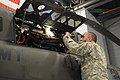 U.S. Army Chief Warrant Officer 3 Kevin J. Carvey, a maintenance test pilot with the 2nd Detachment, 1st Battalion, 224th Aviation Regiment, Vermont Army National Guard, inspects an OH-58 Kiowa Warrior 131103-Z-NB545-770.jpg