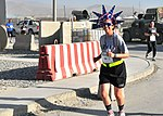 U.S. Army Maj. Crystal Carberry, foreground, a logistics planner with the International Security Assistance Force Joint Command, runs in a satellite 10K race at Kabul International Airport, Afghanistan, held as 130704-A-PP033-730.jpg