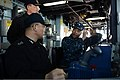 U.S. Navy Cmdr. Thomas Dixon, right, the commanding officer of the guided missile destroyer USS McCampbell (DDG 85), gives a tour of the ship's pilot house to South Korean sailors in Pyeongtaek, South 130311-N-TG831-068.jpg